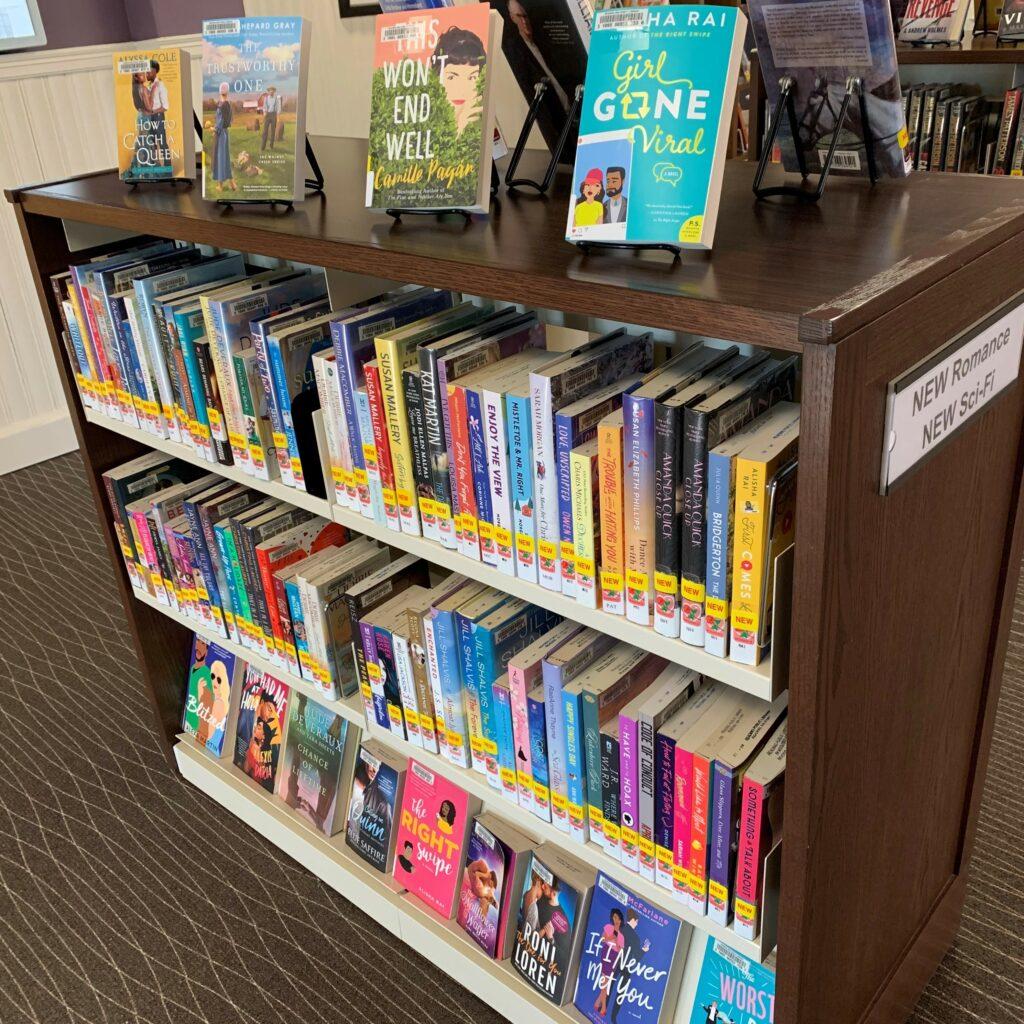 photo of a book shelf containing romance books